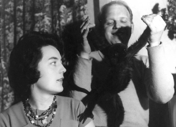 Mum and Dad with their pet spider monkey